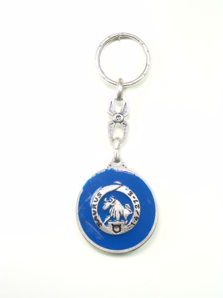 "SOUVENIRS KEYCHAIN ​​HOROSCOPES AND INITIALS ""TAUROS CIRCULAR 1 colored enamel"""