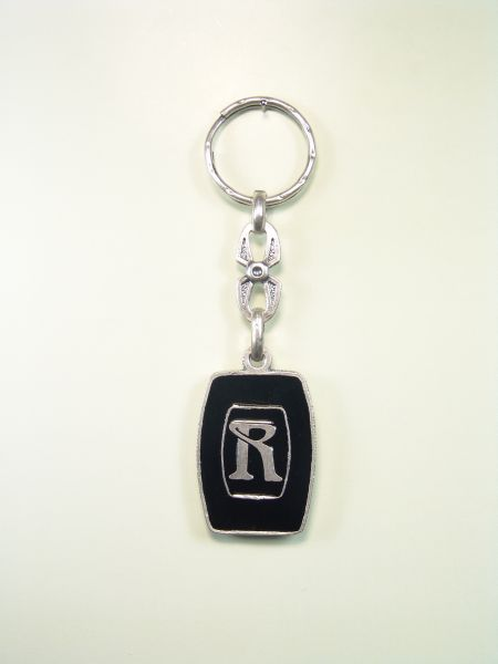 "SOUVENIRS KEYCHAIN ​​HOROSCOPES AND INITIALS ""CIRCULAR LETTER R ON ORLA one colored enamel"""