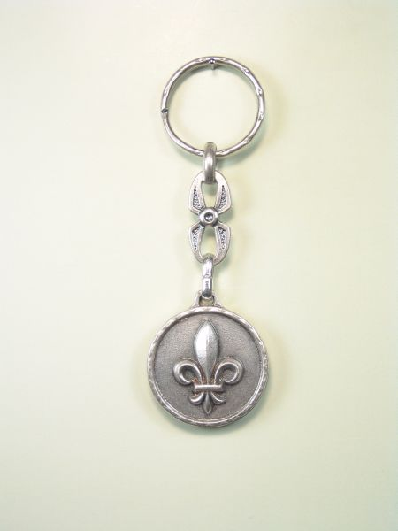 "SEVERAL KEY SOUVENIRS ""ORLA LILY ON CIRCULAR"""